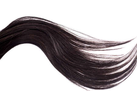 Curvy black long hair isolated on white background, hair extensions close up