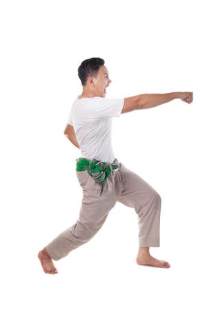 Pencak Silat, Indonesian Malaysian Asian traditional martial art, male warrior or ksatria pendekar performing jurus pencak silat isolated on white, full body portrait