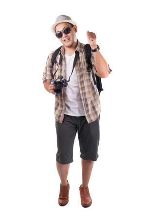 Traveling people concept. Portrait of Asian male backpacker traveler tourist  isolated on white. Full body portrait.Calling gesture with happy smiling face