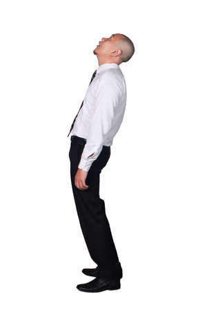 Young businessman wearing white suit and black pants deperate, looking up gesture. Isolated on white. Full body portrait