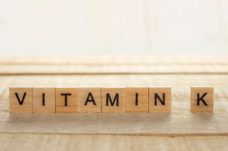 Medical and health care words writing typography lettering concept, Vitamin K