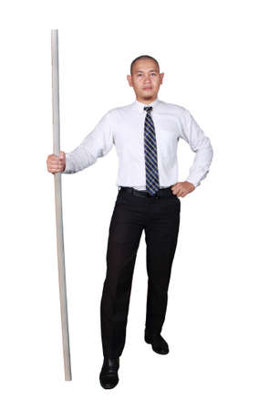 Young businessman wearing white suit and black pants standing and holding a stick, confidence gesture. Isolated on white. Ful body portrait