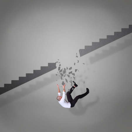 Businessman falling down from broken stairs, failure crisis in business concept Stok Fotoğraf