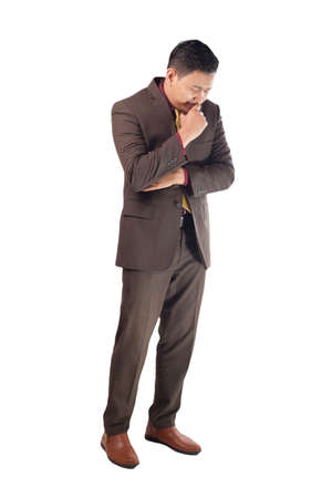 Portrait of Asian businessman sad andcrying, concept of business failure, full body portrait isolated on white