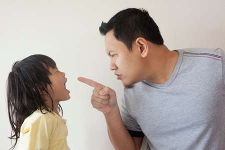 Young Asian father and little baby girl daughter arguing, screaming each other, dad mad at his kid