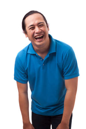 Photo image of funny cute Asian man wearing casual shirt smiling and laughing