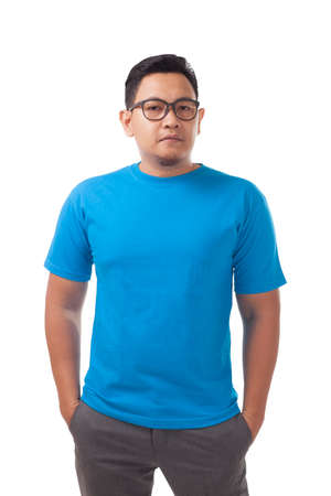 Blue t-shirt mock up, front view, isolated on white. Male model wear plain blue shirt mockup. Tshirt design template. Blank tee for print Banco de Imagens