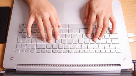 Close up image of businessman hands typing on notebook, copy writer, working on laptop computer