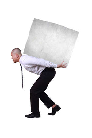 Portrait of businessman under pressure, walking while bearing heavy load on his back, side view profile islated on white