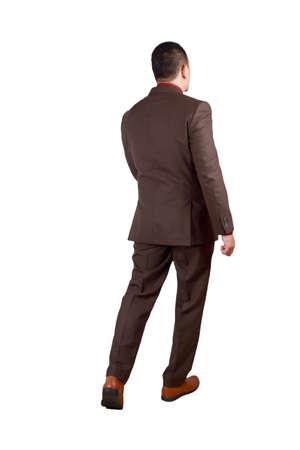 Retrato de cuerpo entero del empresario asiático en traje formal aislado en blanco. Vista trasera del hombre exitoso caballero empresario permanente caminando Foto de archivo