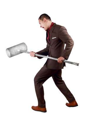 Portrait of businessman wearing brown suit swinging sledgehammer, hitting to break obstacles concept, full length isolated on white
