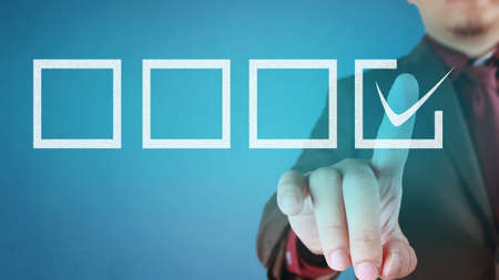 Businessman checking mark on checklist. Making a choice concept. Choosing on from many options