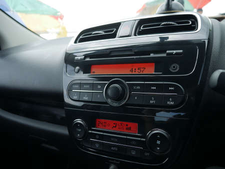 Close up image of car dashboard audio radio air conditioner console