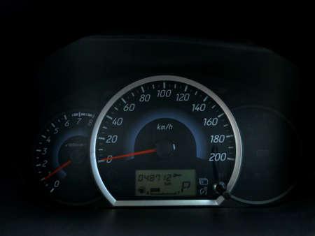 Close up image of car speedometer, dark black space with RPM  gauge Stock Photo