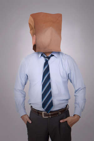 Portrait of businessman covering his face with blank empty paper. copy space mock up for anonymouse person