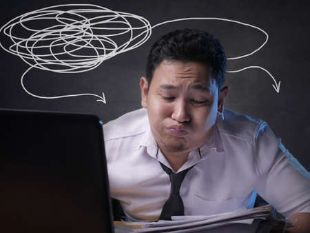 Portrait of Asian man Looked tired upset, depresssed and stressed looking at laptop, sleepy tired stress gesture, bad business pressure, work addict concept 写真素材 - 129700473