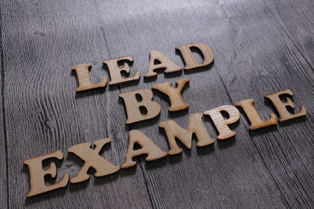 Lead by Example, business motivational inspirational quotes, wooden words typography lettering concept