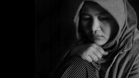 Portrait of sad, depressed, crying muslim woman in black and white, concept of sadness