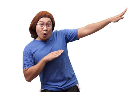 Portrait of funny Asian man smiling and making dab movement, isolated on white