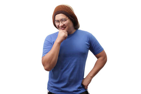 Funny confident Asian man with eyeglasses flirting gesture and smiling, isolated on white