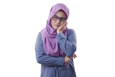 Portrait of Asian muslim woman wearing hijab showing upset disappointed expression. Isolated on white Banco de Imagens