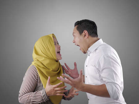 Portrait of Asian muslim couple husband and wife having fight, argue on each other, bad relationship in marriage concept