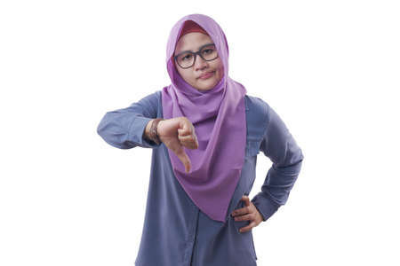 Portrait of muslim businesswoman boss manager leader lady looked angry while showing thumb down gesture, isolated on white