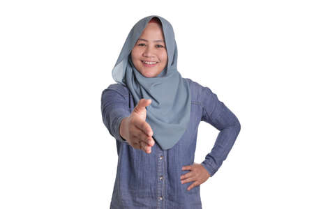 Portrait of muslim businesswoman offers hand shake, deal partnership agreeement concept, selective focus image 스톡 콘텐츠