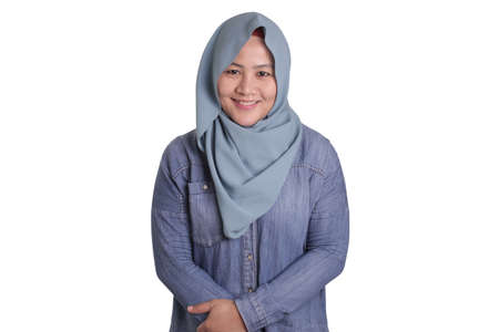 Portrait of beautiful Asian muslim woman wearing blue hijab smiling at camera