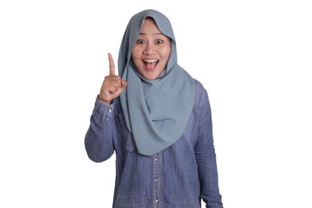Asian muslim businesswomen wearing hijab with curiousity thinking expression. Having good idea, isolated on white