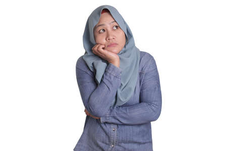 Asian muslim woman wearing hijab with thinking expression. Looking for solution of a problem. Close up portrait isolated on white