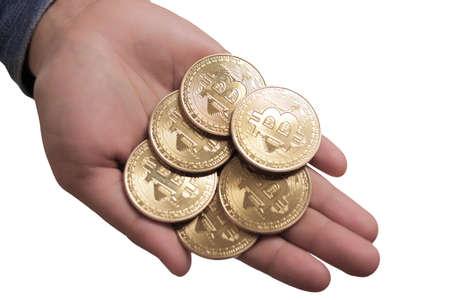 Physical bitcoin currency coins stack on hands, investment in cryptocurrency concept