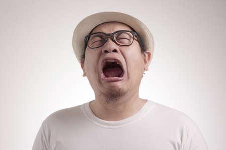 Photo image of funny Asian man crying hard, sad depression frustration hopeless expression