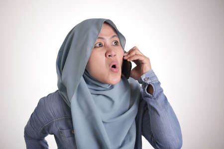 Portrait Of Asian Muslim Woman Wearing Hijab Argue On Phone ...