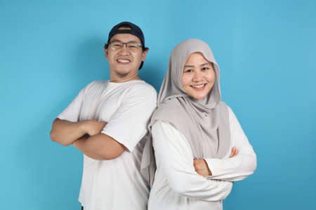 Portrait of happy Asian muslim couple smiling, husband and wife hugging full of love, family concept Stock Photo