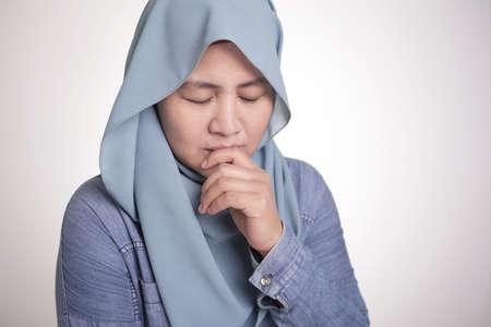 Portrait of sad Asian muslim woman wearing hijab crying, depression concept