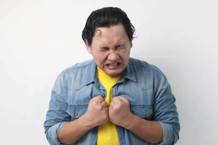Photo image of funny Asian man crying close his eyes, sad depression frustration hopeless expression