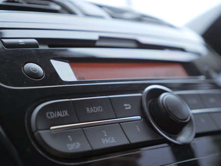 Close up image of car dashboard audio radio system console