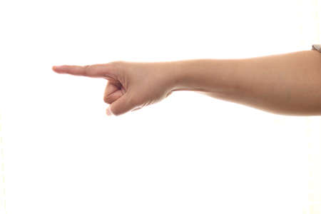 Hand of a person pointing forward, side view, isolated cut out on white background