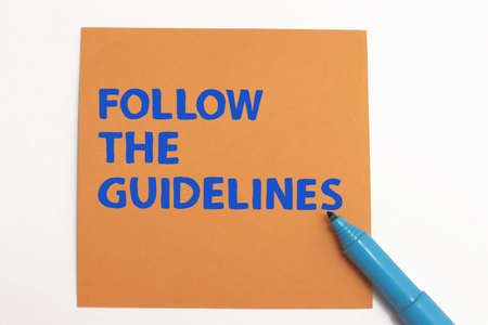 Follow the guidelines, text words typography written on paper against white background, life and business motivational inspirational concept Imagens