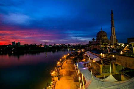 scenery of sunset at public mosque,putrajaya. soft focus,blur due to long exposure. visible noise due to high iso Stock Photo