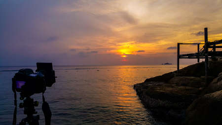 scenery of sunset at Perhentian Island with camera shooting.soft focus, blur due to long exposure.visible noise due to high ISO Stock Photo