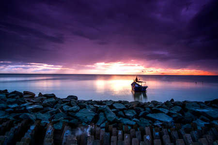 scenery of sunset at Penang,Malaysia.soft focus,blur due to long exposure. visible noise due to high iso Stock Photo