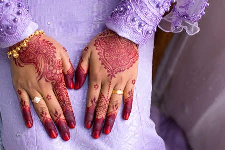 female hand, image of mehendi henna pattern. Short manicure nails. Beautiful composition, fabric background banner. Round mandala abstract flowers, flowers lilac. Close up professional art photo Stock fotó