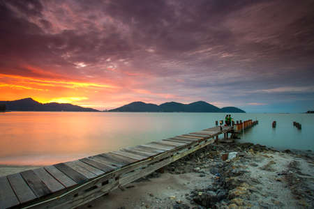 Beautiful view of sunset at Lumut,Perak,Malaysia. soft focus, blur due to long exposure. Visible noise due to high ISO. 스톡 콘텐츠