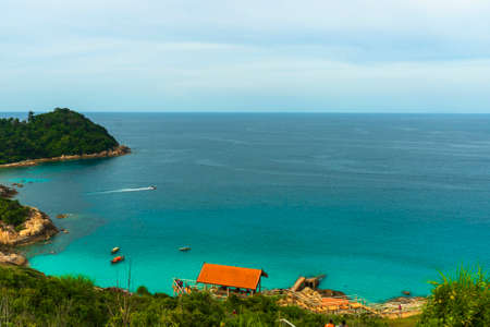 Aerial View of Perhentian Island Bay with clear water and blue sky.