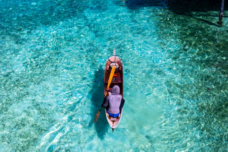 Fisherman At Mabul Island With Their Boat. Stock Photo