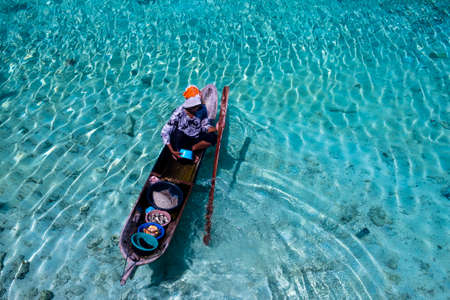 Fisherman At Mabul Island With Their Boat.