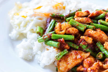 Close up shot Fried stir chicken with red curry paste add yard long bean pour rice Stock Photo - 29462218