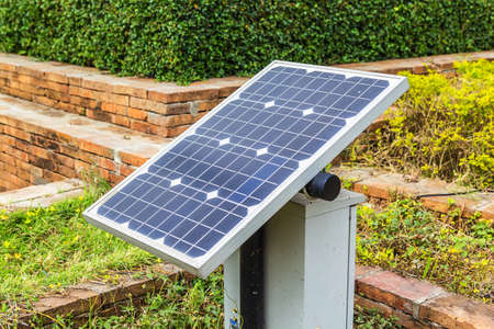 Mini stand electric solar cell in a garden.